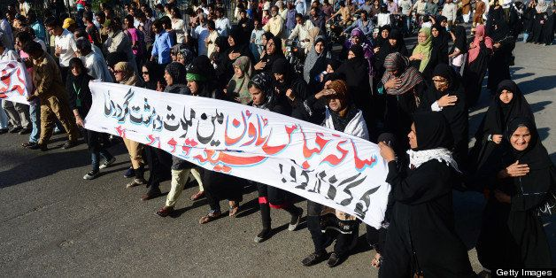 Pakistani Shiite Muslims march during a protest against the killing of their community members in Karachi on March 8, 2013. S