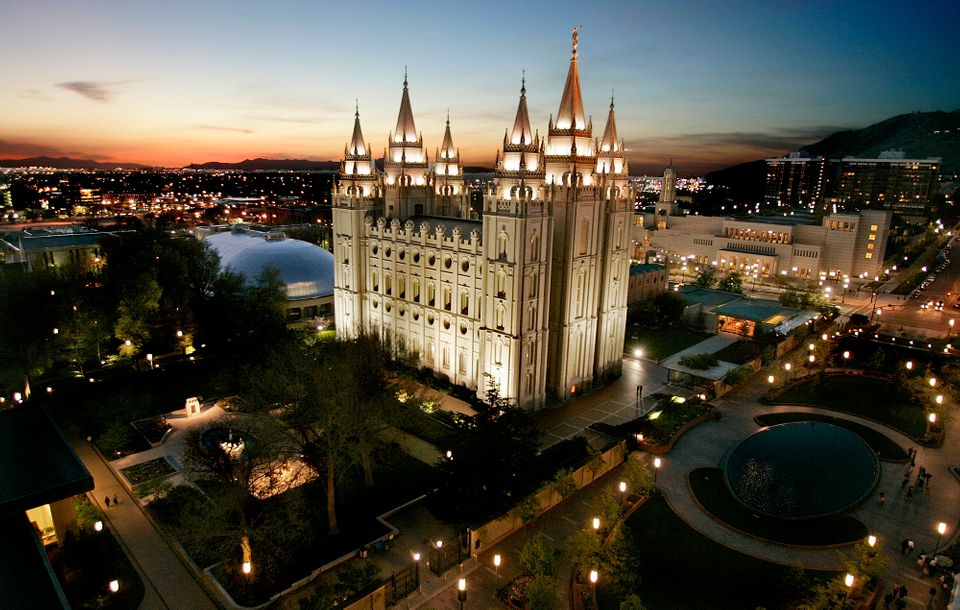 FILE- In this April 27, 2006, file photo, the sun sets behind the Mormon Temple, the centerpiece of Temple Square, in Salt La