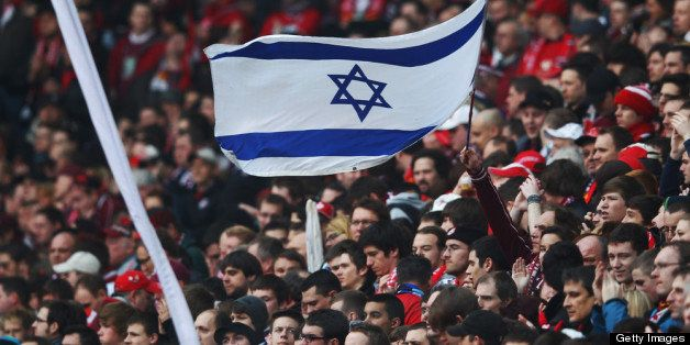 KAISERSLAUTERN, GERMANY - MARCH 03:  Fans of Kaiserslautern hold up an Israelian flag to protest against antisemitism prior t