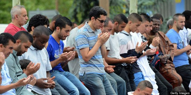 Muslims pray around the mosque of their Basso Combo neighbourhood, in Toulouse, southern France, on July 20, 2012, during the