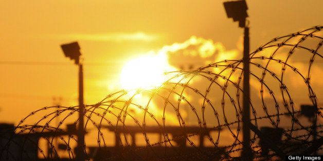 The sun rises over the Camp Delta detention center at the U.S. naval base at Guantanamo Bay, Cuba, on Thursday, Oct. 18, 2012