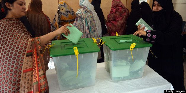 Pakistani residents cast their votes at a polling station in Islamabad on May 11, 2013. Pakistanis queued up to vote in landm