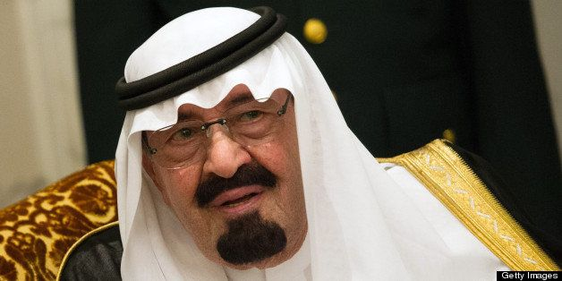 Saudi Arabia's King Abdullah bin Abdulaziz al-Saud talks with French President Francois Hollande (unseen) during their meetin