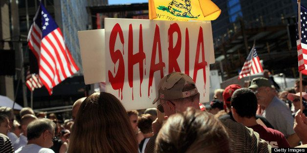NEW YORK - SEPTEMBER 11:  People demonstrate against allowing a mosque near Ground Zero at a rally in lower Manhattan on Sept