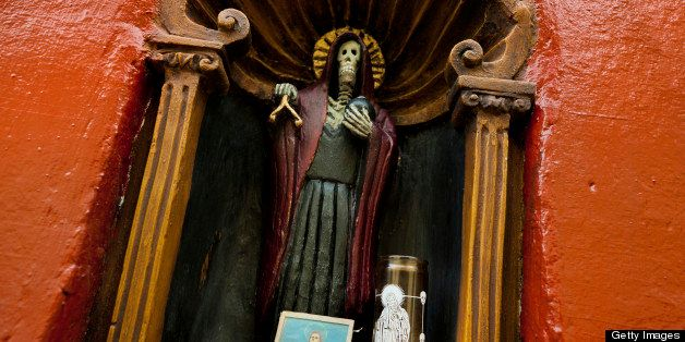 MEXICO CITY, MEXICO - MAY 27: A figurine of Santa Muerte (Saint Death) seen in a temple in the historical center of Mexico Ci