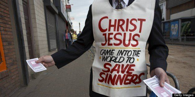 christian religious fundamentalist handing out leaflets in the main street at the ballyclare may fair