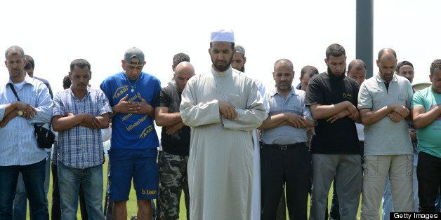 Muslim workers pray after colleagues were killed during an earthquake on May 29, 2012 in a factory in Medolla. As many as 10