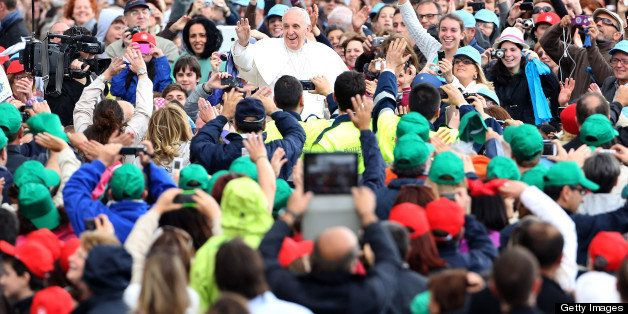 VATICAN CITY, VATICAN - MAY 29: Pope Francis arrives in St. Peter's Square for his weekly audience on May 29, 2013 in Vatican City, Vatican. The Pontiff began his catechesis, which this week began a new series of reflections on the mystery of the Church, based in the documents of the II Vatican Council. (Photo by Franco Origlia/Getty Images)