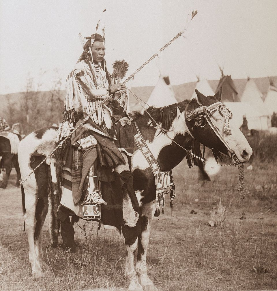 Spotted Rabbit (Crow) on horseback ca. 1905