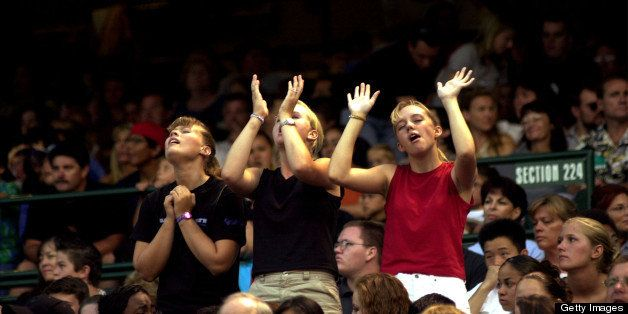 392102 05: Girls praise Jesus as British Christian rock band Delirious performs and evangelizes during a Harvest Crusade gath