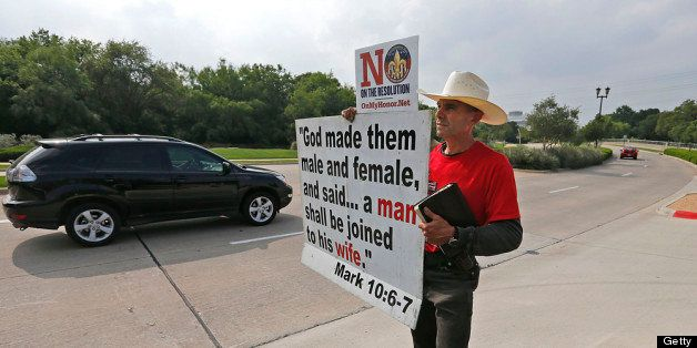GRAPEVINE, TX - MAY 23:  Alan Hoyle, of Lincolnton, North Carolina holds up a sign opposing gays in the Boy Scouts at the Gay