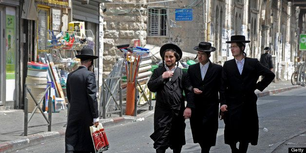 Ultra-Orthodox Jewish men walk around in the Me'a She'arim neighborhood in Jerusalem, Israel, on Sunday, Aug. 1, 2010. Almost 60 percent of Israel's ultra-Orthodox men don't have jobs. The second-fastest-growing population group in the country after the Bedouin, they have prompted Bank of Israel Governor Stanley Fischer and Finance Minister Yuval Steinitz to assert that the haredim, as they are called in Hebrew, may impede Israel's prosperity. Photographer: Ahikam Seri/Bloomberg via Getty Images