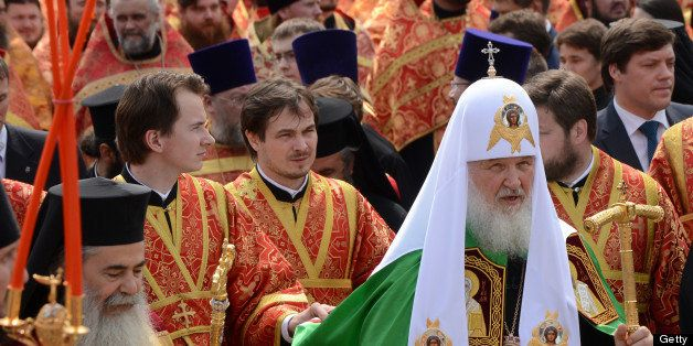 Russian Orthodox Patriarch Kirill (front R) takes part in a religious procession marking Saints Cyrilius and Methodius' Day i
