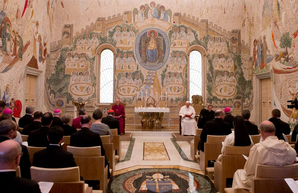 Pope Francis prays with the Archbishop of Canterbury Justin Welby, in a chapel at the Vatican after a private audience Friday