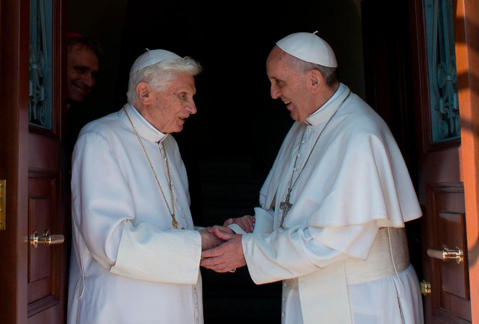 In this photo provided by the Vatican newspaper L'Osservatore Romano, Pope emeritus Benedict XVI, left, is welcomed by Pope F