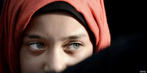 A young Bahraini girl attends an anti-government rally to support Bahraini top senior Shiite cleric, Sheikh Isa Qassim, in th