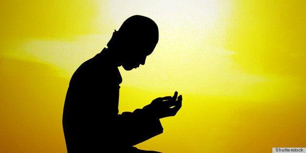 silhouette of a muslim praying...