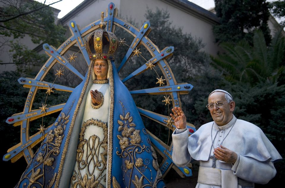 A life-size statue of Pope Francis is seen alongside a statue of the Virgin of Lujan at the site of the Buenos Aires Cathedra