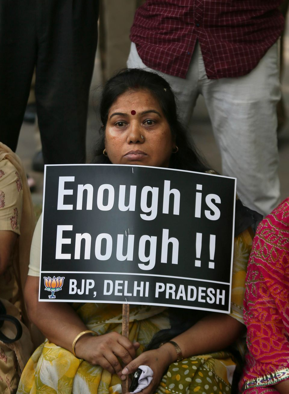 An Indian woman holds a placard during a protest to demand for tougher rape laws and better police protection for women, outs