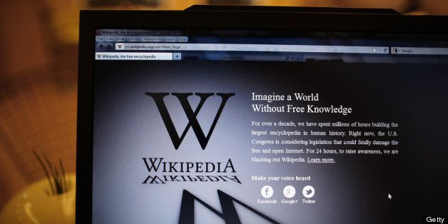 LONDON, ENGLAND - JANUARY 18:  A laptop computer displays Wikipedia's front page showing a darkened logo on January 18, 2012