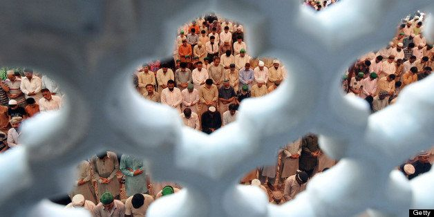 Pakistani Muslims offer Friday prayers at mosque during the month of Ramadan in Lahore on July 19, 2013. Islam's holy month o