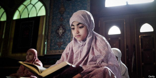 Young Bahraini Shiite Muslim girls read the Koran, Islam's holy book, during the holy fasting month of Ramadan at a mosque in