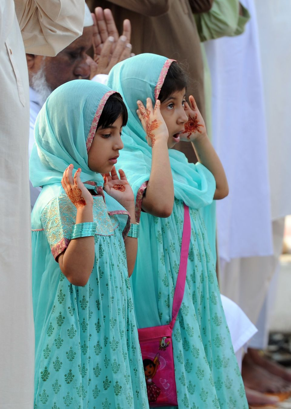 Young Pakistani Muslim girls offer Eid al-Fitr prayers outside the Red Mosque during the first day of their religious festiva