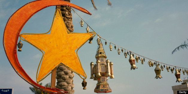 Kuwait, Kuwait City, Gulf Road. Crescent moon and lantern decorations for Eid at the end of Ramadan.