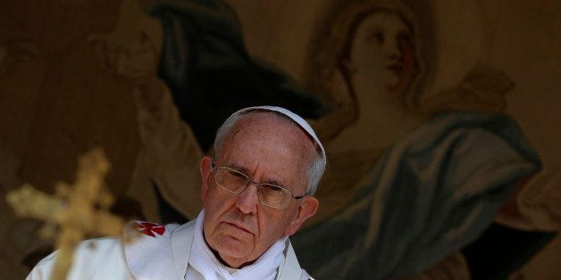 Pope Francis celebrates the Assumption Day mass in the Castelgandolfo's central square on August 15, 2013.     AFP PHOTO / PO