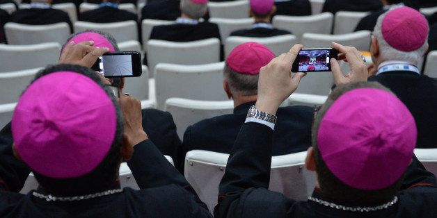 Bishops take pictures of Pope Francis with mobile phones at the Archbishop's Palace in Rio de Janeiro, Brazil on July 27, 201