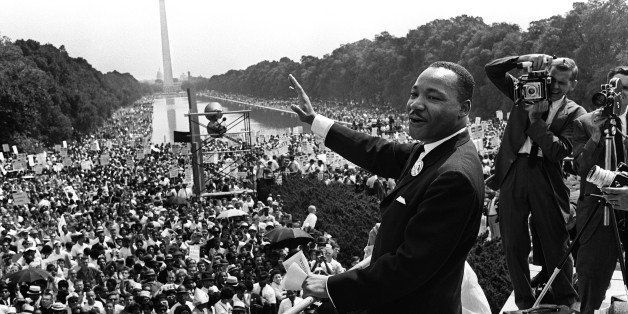 The civil rights leader Martin Luther KIng (C) waves to supporters 28 August 1963 on the Mall in Washington DC (Washington Mo