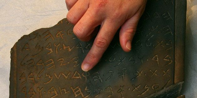 JERUSALEM - MARCH 27:  An Israeli archaeologist reviews the inscription on the Jehoash tablet in the storerooms of the Israel