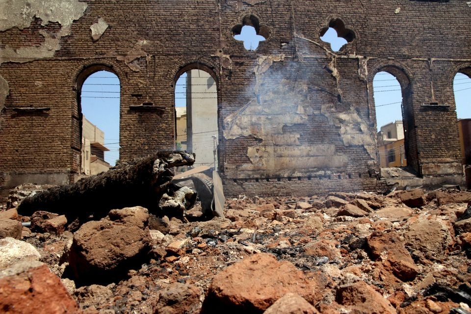 The smoldering ruins of the Evangelical Church of Malawi are seen after it was ransacked, looted and burned on Thursday by an