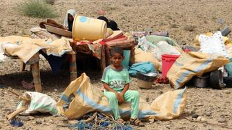 A displaced Yemeni boy from the border area of Hiran with Saudi Arabia sits at an improvised camp for displaced people in the northern province of Hajjah on August 29, 2018. - A Saudi-led coalition battling in Yemen today dismissed as inaccurate a report by UN investigators that highlighted possible war crimes in the conflict-torn country including deadly air strikes by the alliance. (Photo by ESSA AHMED / AFP)        (Photo credit should read ESSA AHMED/AFP/Getty Images)