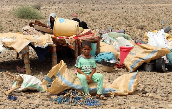 A Yemeni boy sits at an improvised camp for displaced people in the northern province of Hajjah on August 29.