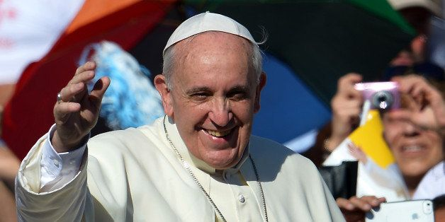 Pope Francis salutes as he arrives for his weekly open-air general audience on September 4, 2013 in St.Peters square at the V