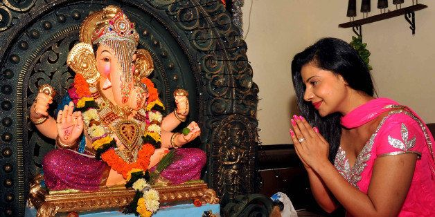 Indian Bollywood film actress Sambhavana Seth offers prayers to an idol of Hindu God Lord Ganesh during the festival of 'Gane
