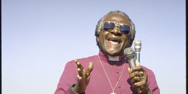 Anti-Apartheid activist Bishop Desmond M. Tutu pleading with crowd to save the life of a suspected police informant whose car