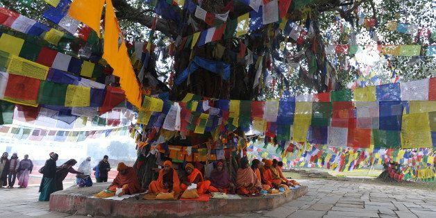 Nepalese Buddhists monks pray outside the Mayadevi (Buddha's mother) temple, birth place of Lord Buddha, Lumbini 400 kms (250