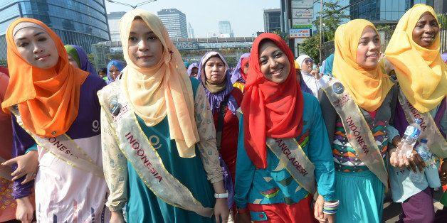 Contestants of the World Muslimah contest, Nanzin Sultana Liza (C, red headscarf) of Bangladesh, Obabiyi Aishah (R) of Nigeri