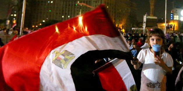 An Egyptian girl waves her country's flag in Cairo's landmark Tahrir square on July 19, 2013, during the 'Tenth of Ramadan' c