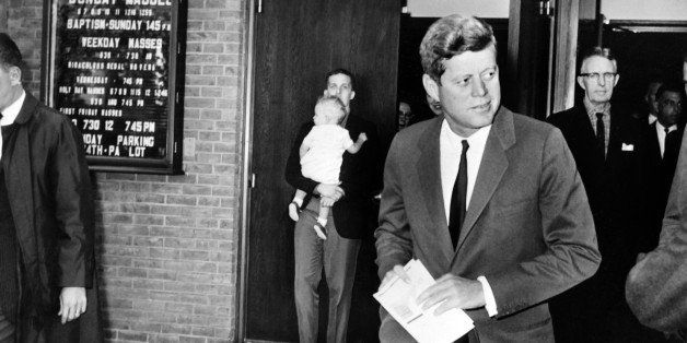 US President John Fitzgerald Kennedy leaves the Saint Stephen Martyr catholic church after attending mass, on October 28, 196