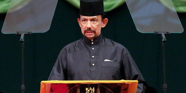 Brunei Sultan Hassanal Bolkiah delivers his speech during the official opening of the Majlis Ilmu 2013 in Bandar Seri Begawan