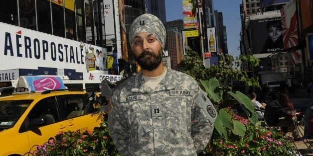 TO USE WITH AFP STORY by Shaun Tandon, US-MILITARY-RELIGION-SIKHS US Army Captain Kamaljeet Singh Kalsi poses in Times Square