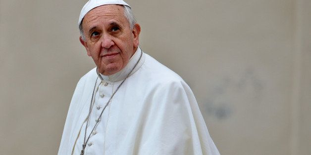 Pope Francis arrives at Saint Peter square  to lead his weekly general audience, on November 13, 2013 in the Vatican.    AFP