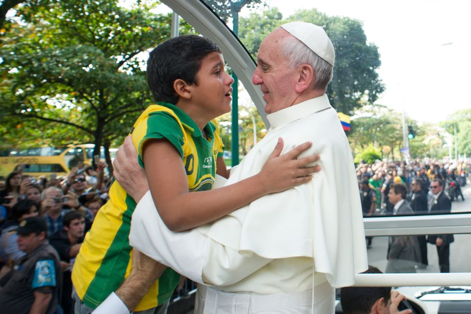 Meet Nathan de Brito, the little boy who broke past barriers to run into Pope Francis' arms on Friday in order to tell him so