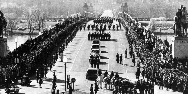 381091 10: The funeral procession of President John F. Kennedy goes into Arlington Cemetary in Washington. On November 22, 19