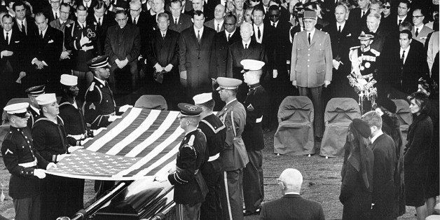 381091 61: Honor guard place a flag over the casket of President John F. Kennedy during his funeral service November 25, 1963