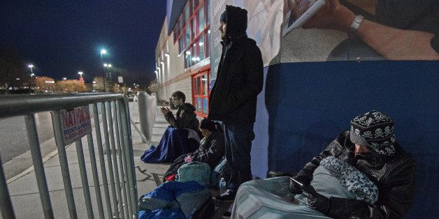 Gamer Josh Aaront (L rear) waits first in line at the Fairfax, Virginia, Best Buy, with about  20 other sidewalk campers,  fo