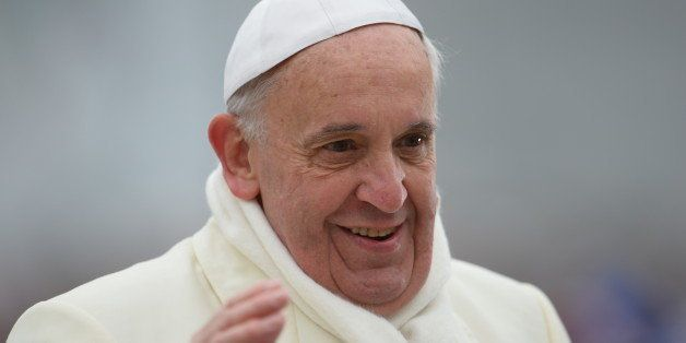 Pope Francis greets the crowd as he arrives for his general audience at St Peter's square on November 27, 2013 at the Vatican. AFP PHOTO / VINCENZO PINTO (Photo credit should read VINCENZO PINTO/AFP/Getty Images)